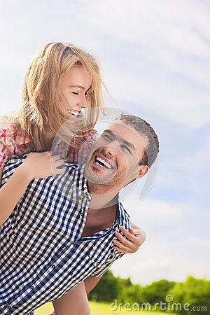 Free Portrait Of Happy And Cheerful Young Caucasian Couple Piggybacki Royalty Free Stock Image - 50050046