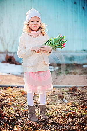 Free Portrait Of Happy Child Girl With Tulips For Woman S Day On The Walk In Early Spring Stock Image - 50767321