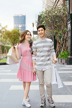 Free Portrait Of Happy Couple With Shopping Bags After Shopping In Ci Stock Images - 120540164