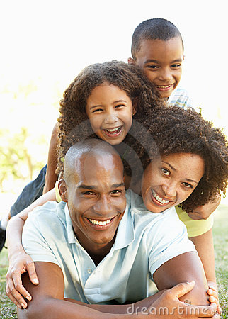 Free Portrait Of Happy Family Piled Up In Park Royalty Free Stock Photo - 15254725