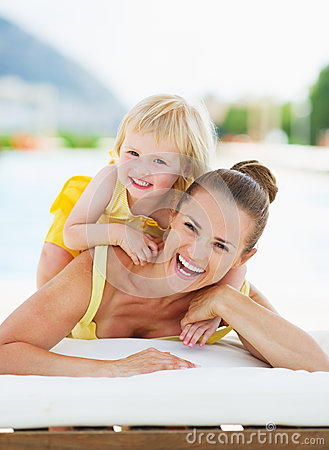 Free Portrait Of Happy Mother And Baby At Poolside Royalty Free Stock Images - 32354689