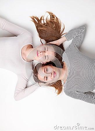Free Portrait Of Happy Sisters Lying On The Floor Stock Photo - 84106220