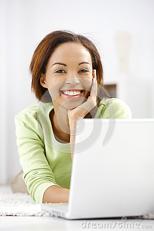 Free Portrait Of Laughing Ethnic Girl With Laptop Stock Photos - 28432453