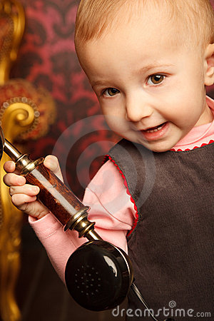 Free Portrait Of Little Girl Holds Up Retro Phone Royalty Free Stock Photography - 12729417