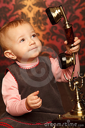 Free Portrait Of Little Girl Holds Up Retro Phone Royalty Free Stock Photos - 12729438