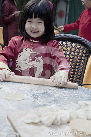 Free Portrait Of Little Girl Making Dumplings In Traditional Clothing Stock Image - 33394291