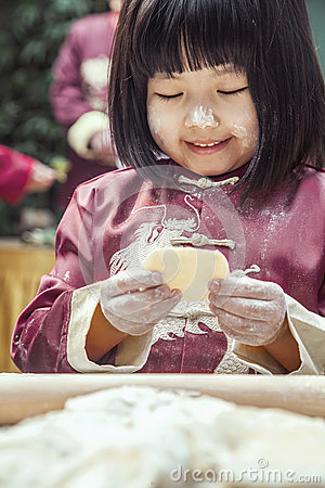 Free Portrait Of Little Girl Making Dumplings In Traditional Clothing Royalty Free Stock Photography - 33394297