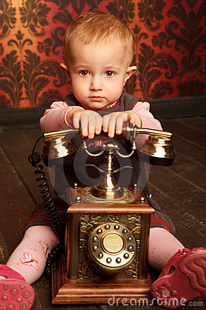 Free Portrait Of Little Girl Sitting With Retro Phone Stock Photos - 12729433