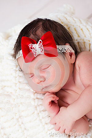 Free Portrait Of Little Newborn Baby Girl With A Red Bow On Her Head. Sleeping Kid. Royalty Free Stock Photos - 66248668