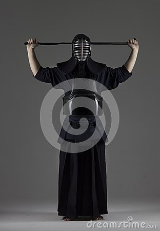 Free Portrait Of Male In Tradition Kendo Armor Putting His Helmet And Preparing For The Fight Stock Photos - 101856183