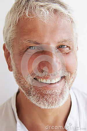 Free Portrait Of Mature Man Standing Against Wall Royalty Free Stock Photo - 54996775