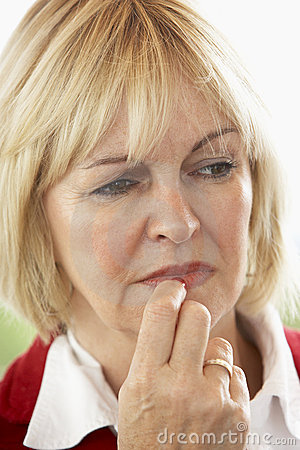 Free Portrait Of Middle Aged Woman Frowning Stock Photo - 7881920