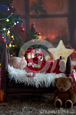 Free Portrait Of Newborn Baby In Santa Clothes In Little Baby Bed Stock Image - 103997131