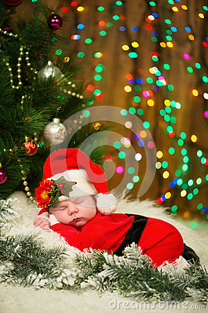 Free Portrait Of Newborn Baby In Santa Clothes Lying Under Christmas Tree. Stock Image - 82044481