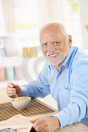 Free Portrait Of Older Man Eating Cereal Royalty Free Stock Photos - 34462038
