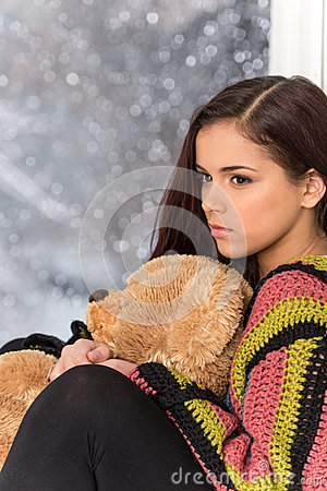 Free Portrait Of Pretty Girl In Sweater Holding Toy. Stock Photography - 43292562