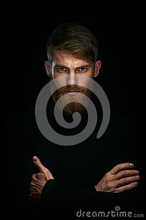 Free Portrait Of Serious Young Man With Folded And Crossing Hands Sta Stock Image - 86065411