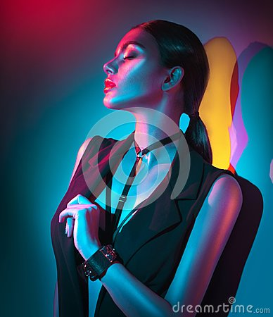 Free Portrait Of Sexy Woman In Black Clothes, Fashion Accessories, Bright Makeup In Neon Light Stock Images - 104702334
