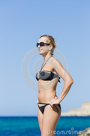 Free Portrait Of Short-haired Smiling Blond Woman Against Sea Stock Images - 114415234