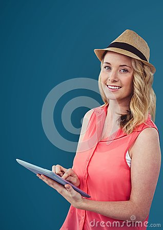 Free Portrait Of Smiling Woman Holding Digital Tablet Against Blue Background Royalty Free Stock Photo - 92876165