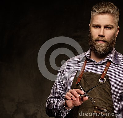 Free Portrait Of Stylish Barber With Beard And Professional Tools On A Dark Background. Royalty Free Stock Photos - 69023948