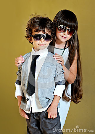 Free Portrait Of Stylish Little Boy And Girl Royalty Free Stock Image - 36879316