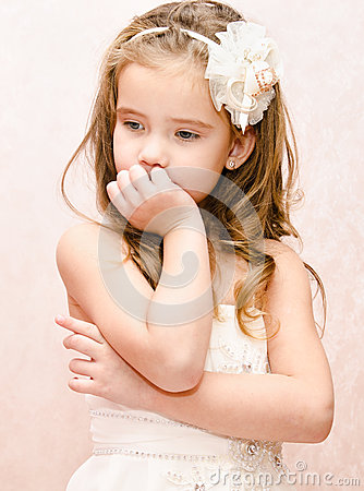 Free Portrait Of Thoughtful Adorable Little Girl In Princess Dress Stock Photography - 39388932
