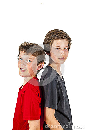 Free Portrait Of Two Boys Standing Back To Back Royalty Free Stock Image - 40575386