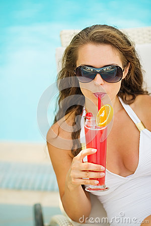 Free Portrait Of Woman In Swimsuit Drinking Cocktail Royalty Free Stock Photos - 28610238