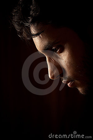 Free Portrait Of Young Indian Angry Man Over Dark Royalty Free Stock Photos - 21053608