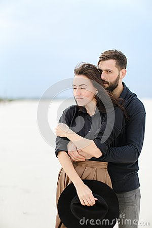 Free Portrait Of Young Man Hugging Woman In Monophonic Background. Stock Photo - 116373160