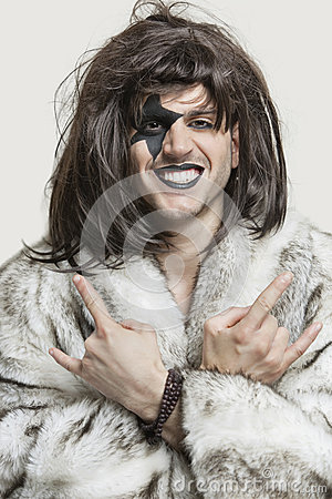 Free Portrait Of Young Man With Painted Face Making Rebellious Gestures Over Gray Background Stock Photo - 30854650