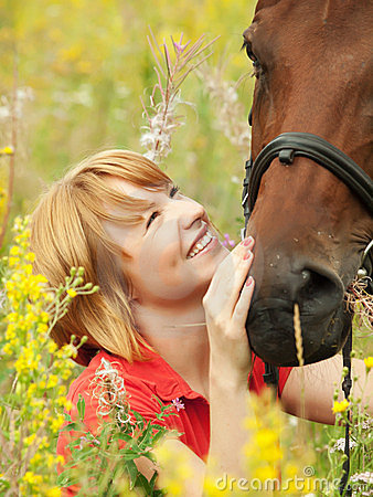 Free Portrait Of Young Nice Girl With Her Horse Royalty Free Stock Image - 23727506