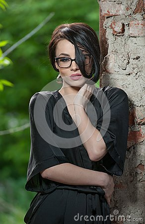 Free Portrait Of Young Woman In Black Silk Dressing Gown, Leaning Against The Wall. Beautiful Seductive Short-haired Woman Royalty Free Stock Photos - 106801928