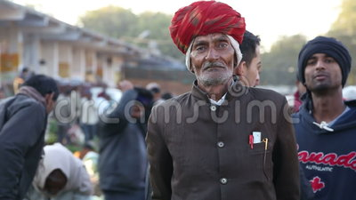Portrait of old Indian man in formal clothing at market in Jodhpur. JODHPUR, INDIA - 12 FEBRUARY 2015: Portrait of old Indian man in formal clothing at market stock video