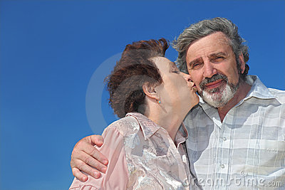 Portrait of old woman kissing man cheek Stock Photo