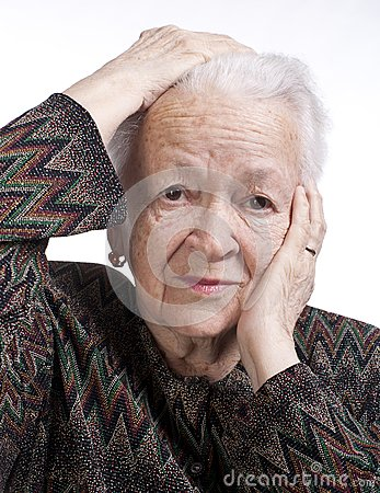 Portrait of old woman suffering from a headache
