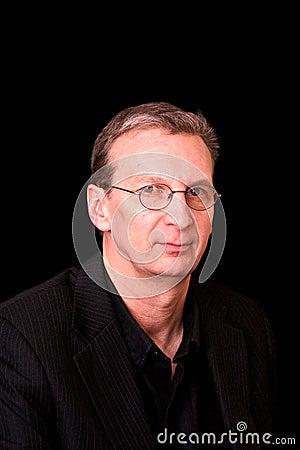 Portrait of older man in black