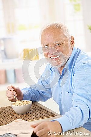 Portrait of older man eating cereal