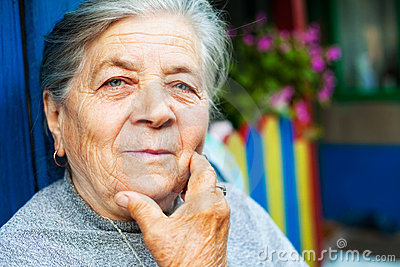 Portrait of one content old senior woman