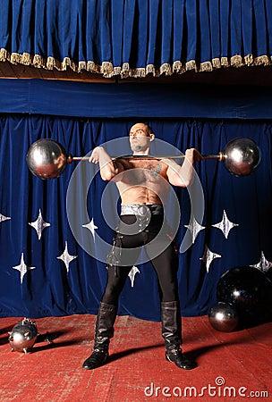 Portrait of one-eyed circus athlete.