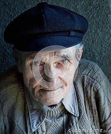 Portrait of one friendly old senior man