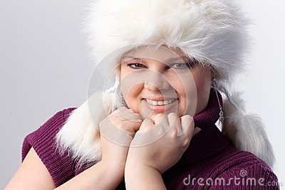 Portrait of overweight woman in white fur hat