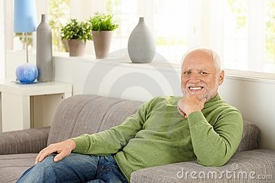 Portrait of pensioner on couch