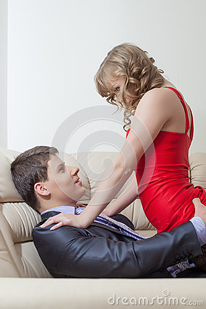 Portrait of playful sexy girl tempts businessman