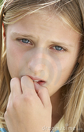 Portrait Of Pre-Teen Girl Biting Her Nails