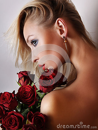 Portrait of pretty blonde  girl with flowers.