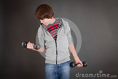 Portrait of pretty boy with dumbbells