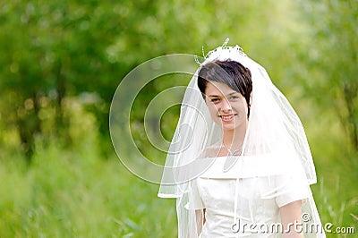 Portrait of pretty brunette bride