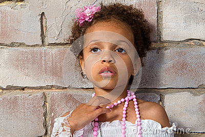 Portrait of a pretty little girl mulatto. Thoughtful lady